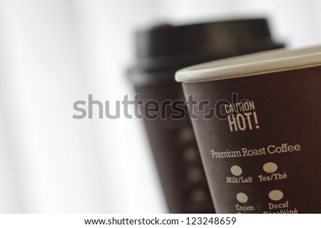 Hot caution sign on coffee cup - stock photo
