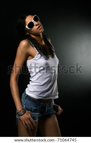 Hot chick in white tshirt and sunglasses - stock photo