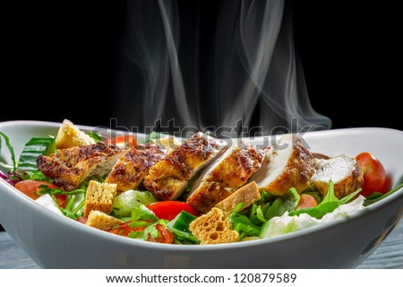 Hot chicken and fresh vegetables as a healthy salad - stock photo