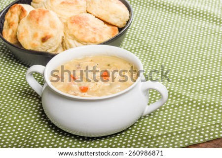 Hot chicken soup with skillet baked biscuits - stock photo