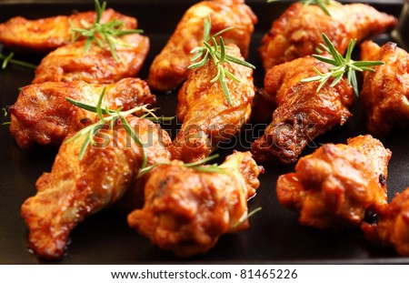 Hot chicken wings on baking tray