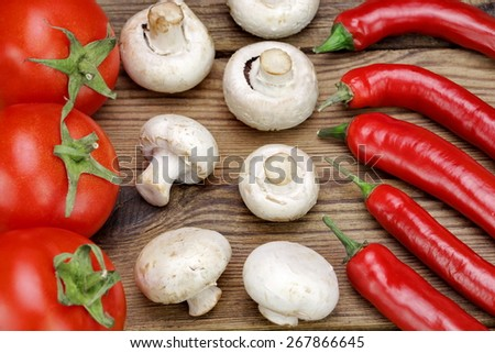 Hot Chili Peppers, Fresh Tomatoes and  Mushrooms On Rustic Wooden Table Background.  Ingredients for Soup, Salad, Paste - stock photo