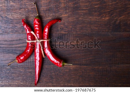 hot chili peppers on wooden background - stock photo