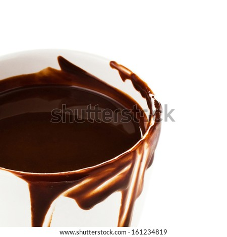 Hot  chocolate cocoa in a cup flow on white background, close up - stock photo