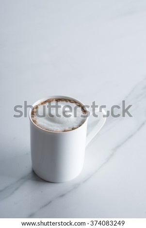 hot chocolate drink in white mug on marble table - stock photo