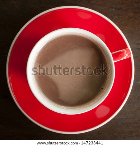 Hot chocolate in a glass of red - stock photo