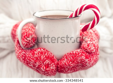 Hot chocolate in the hands. Close up - stock photo