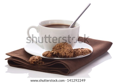 Hot chocolate in white cup on brawn table-napkin isolated on white - stock photo