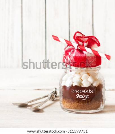 Hot chocolate mix with marshmallow in glass jar for christmas holiday drink or present. - stock photo