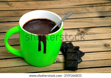 Hot chocolate on wooden table - stock photo