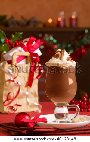 Hot chocolate or Irish coffee at Christmas with presents in festive setting - stock photo