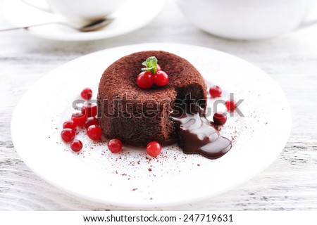 Hot chocolate pudding with fondant centre on plate, close-up - stock photo