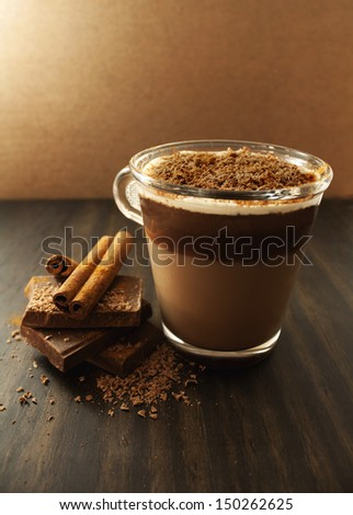 Hot chocolate with cinnamon and cream. - stock photo