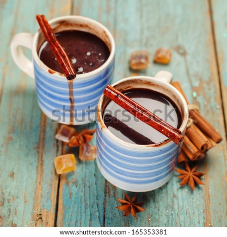 Hot chocolate with cinnamon. Shallow depth of field - stock photo
