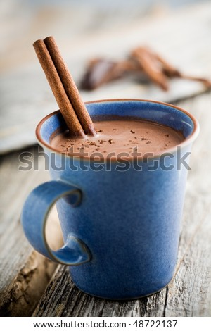 Hot chocolate with cinnamon stick as spoon - stock photo