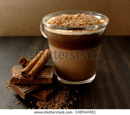 Hot chocolate with cream and cinnamon - stock photo