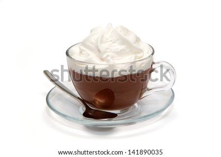 Hot chocolate with cream in glass cup - stock photo