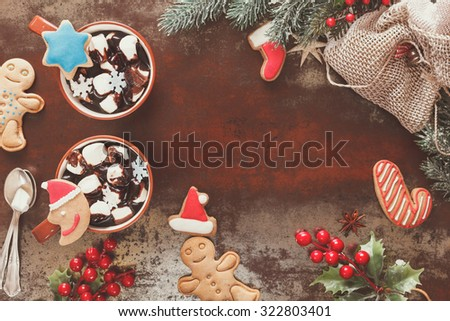 Hot Chocolate with marshmallows and gingerbread cookies in a Christmas setting. Festive decoration. Vintage style with blank space, top view - stock photo