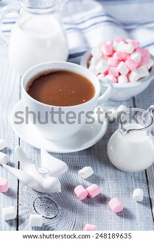 Hot chocolate with marshmallows and two milk jars - stock photo