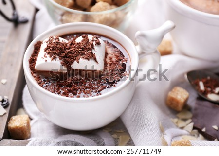 Hot chocolate with marshmallows in mug, on tray, on color wooden ...