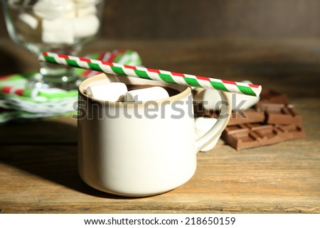 Hot chocolate with marshmallows, on wooden background - stock photo