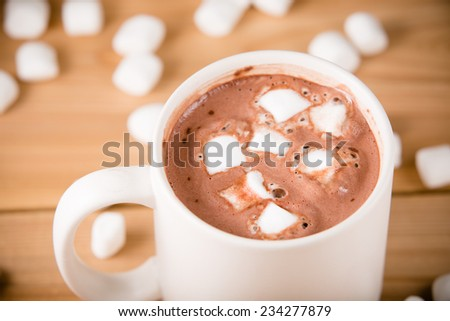 Hot Chocolate With Marshmallows - This is a shot of a hot cup of hot chocolate with marshmallows. Shot with a shallow depth of field.  - stock photo