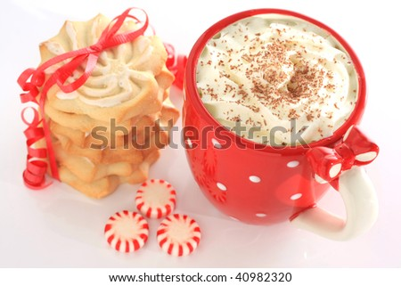 Hot chocolate with shortbread cookies and peppermint candies. Shallow dof, focus on the hot chocolate. - stock photo