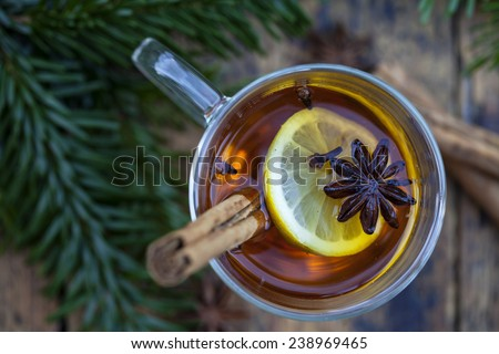 Hot cider with winter spices - stock photo