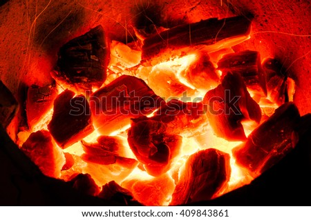 Hot coals in the fire - stock photo