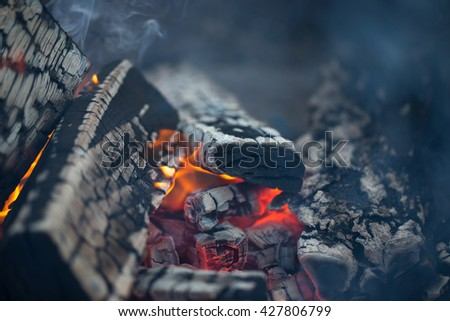 Hot coals of a bonfire. Defocused. - stock photo
