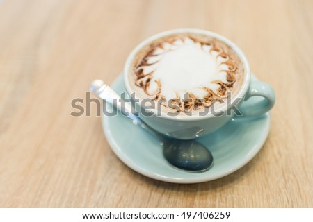 Hot coco on wood table. shallow depth of field