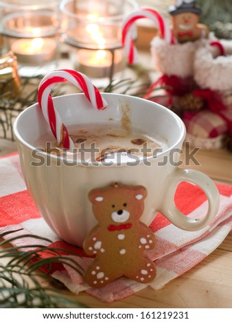 Hot cocoa drink with candy stick, selective focus