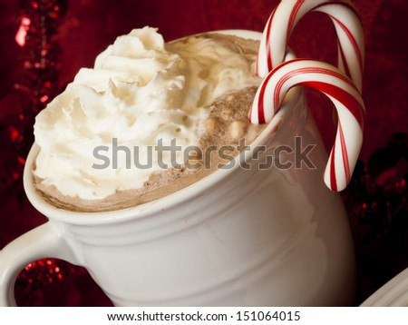 Hot cocoa with candy canes and few cookies. - stock photo