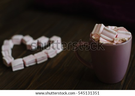 Hot cocoa with marshmallows with  on the old wooden boards. Coffee, cocoa, cinnamon, nuts, cozy sweater Autumn Still Life . Valentines Day concept