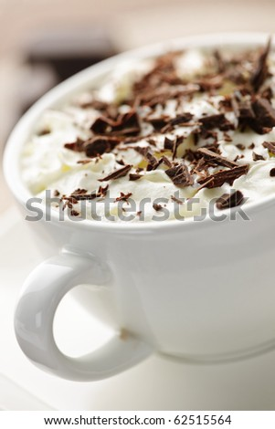 Hot cocoa with shaved chocolate and whipped cream