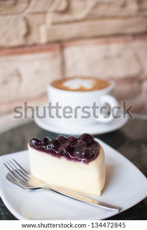 Hot coffee  and blueberry cheesecake. - stock photo
