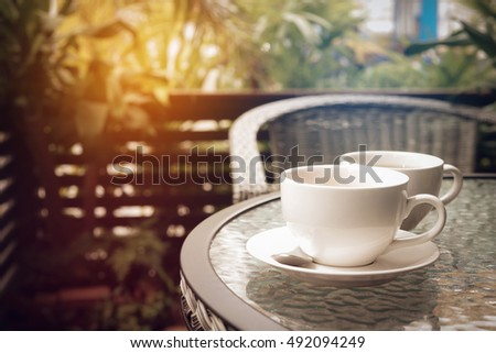 hot coffee espresso and tea with nature background in garden. with vintage filter