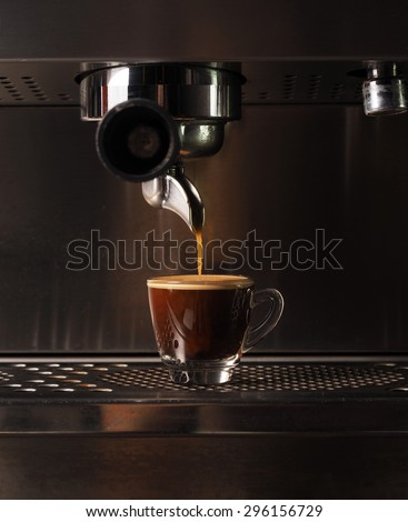 Hot coffee flow to a cup on espresso machine - stock photo