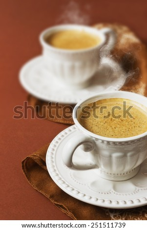 hot coffee in ceramic cups of coffee on a brown background. drinks. selective focus - stock photo