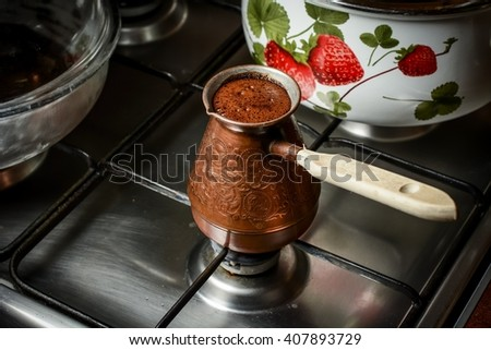 Hot coffee in Turkish on cook stove - stock photo