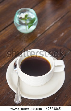 Hot Coffee is located on a wooden table.
