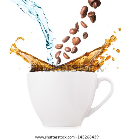 hot coffee is splashing in cup. water and beans are blending