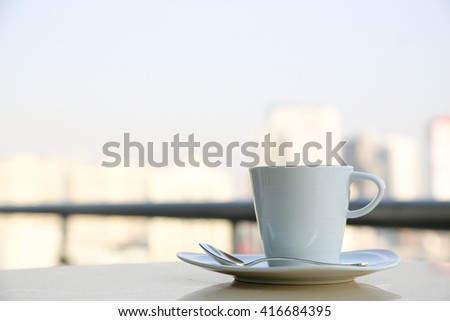 Hot coffee on the tallest building in Bangkok ,cappuccino, Morning,balcony,capital Background ,thailand.