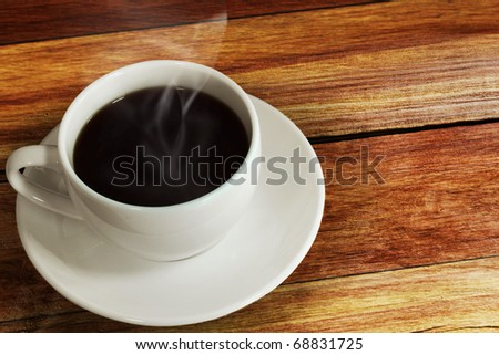 Hot coffee on the wood