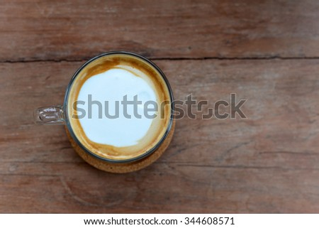 Hot coffee on wood background (Hot Latte) - stock photo
