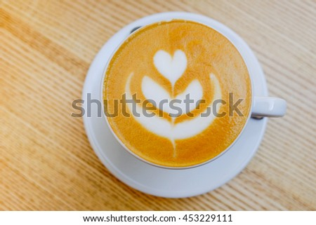 hot coffee on wood table - stock photo
