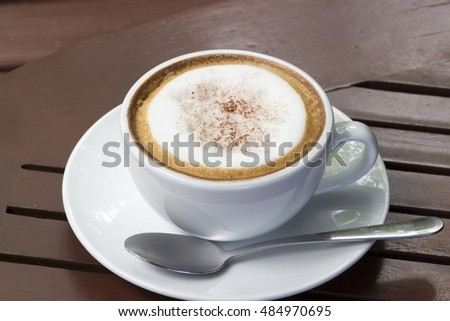 hot coffee on wood table