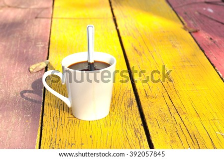Hot coffee on wooden plank, Black coffee - stock photo