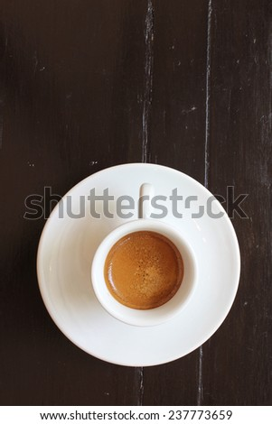 Hot coffee on wooden table - stock photo