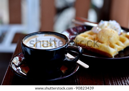hot coffee served with waffle and ice cream - stock photo